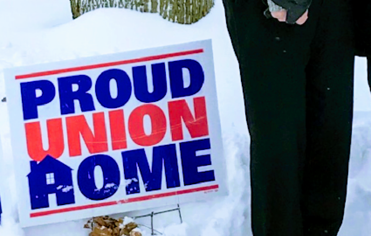 ADC President Jim Allen and his wife Lin display their proud union home sign.